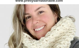 Picture is of women wearing a crochet textured crochet cowl in thick yarn.