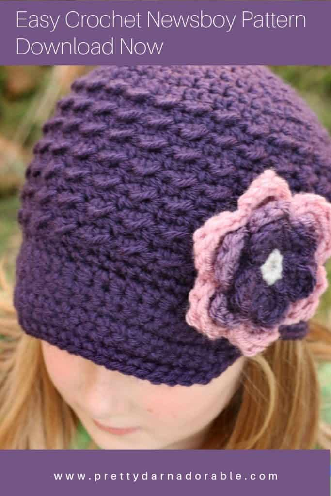 purple texture newsboy cap on girl with flowers