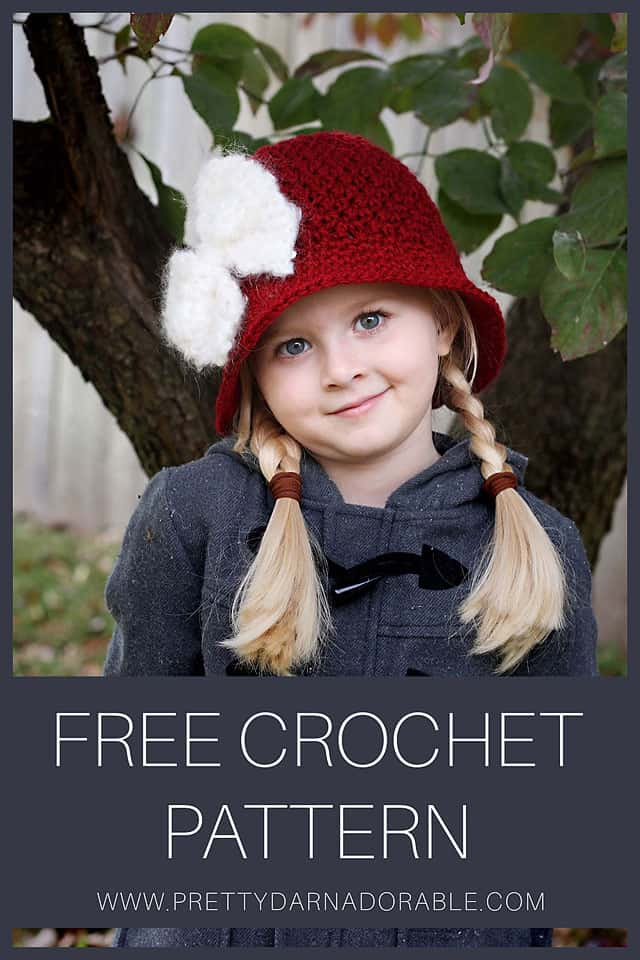 child wearing red crochet cloche with white crochet bow